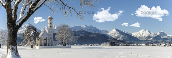 panorama landscape with famous church st. coloman in bavaria at winter