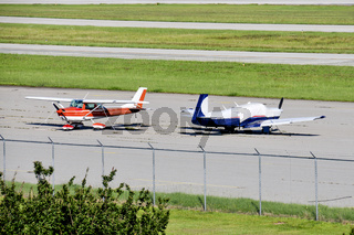 Small Airplanes on a runway