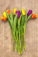 Bouquet of tulips on wooden background.Top view.