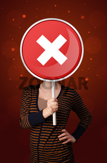 Woman holding x sign