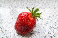 A single fresh strawberry