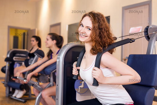 Young woman doing exercises in gym