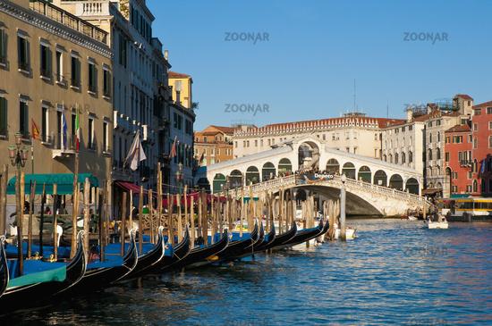 Gondolas at Rialto bridge across the Great Channel located at Ve