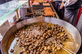 Pan with greasy mushrooms at the Christmas market in Braunschweig, Germany