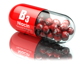 Vitamin B3 capsule. Pill with Niacin or nicotinic acid. Dietary supplements.
