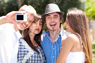 Group of College students standing together taking a self portrait