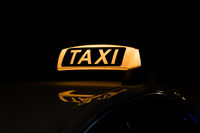 taxi sign illuminated, taxi sign at night