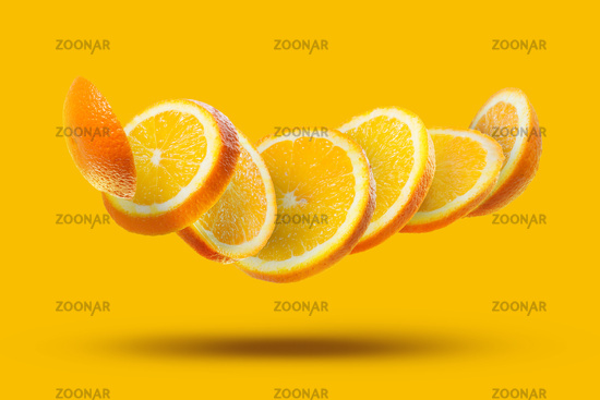 flying orange slices isolated