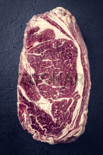 Raw dry aged Entrecote Steak as Vintage on a slate