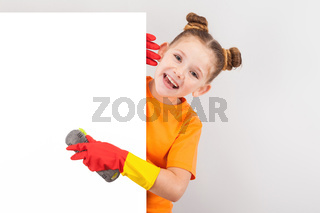 happy little girl in gloves with brushes