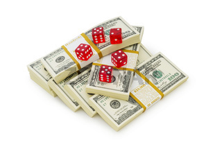 Red dice and dollars isolated on white