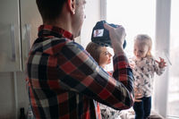 Father taking photo of his daughter and wife