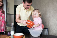 Dad and daughter together in the kitchen
