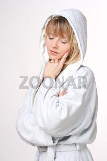 Beautiful Blond Woman In Hooded White Bathrobe