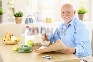 Portrait of healthy senior at breakfast