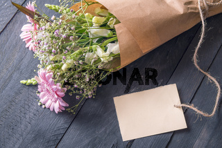 Message card and a bouquet of flowers