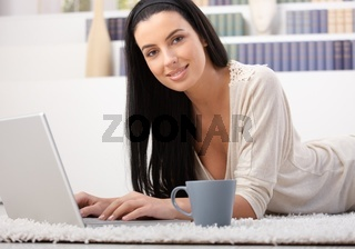 Attractive woman with laptop at home