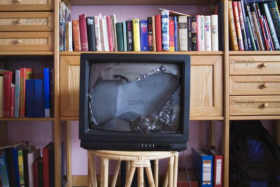 Broken television in a living room