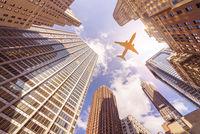 plane over skyskrapers