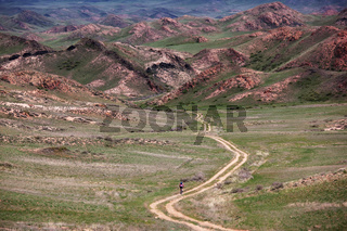 Old rural road in desert mountain