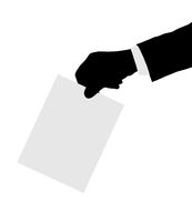 Hand with paper ballot