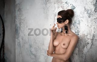 beautiful sexy woman topless takes a milk bath