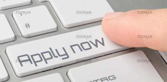 A keyboard with a labeled button - Apply now