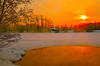 Sunset on river in winter
