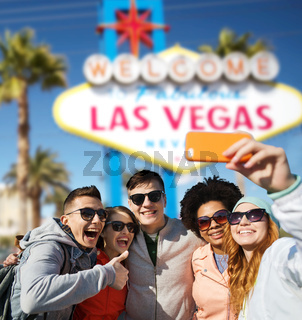 friends travelling to las vegas and taking selfie