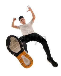 Hansome rap dancer in baseball cap shot from above