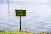 Warning sign at the bathing lake