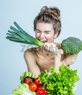 Young woman with vegetables