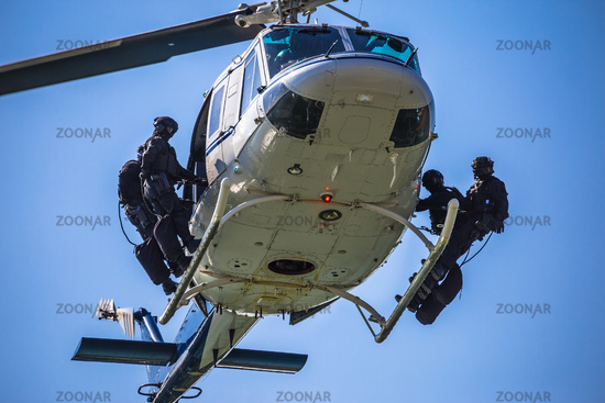 Special forces team ready for helicopter rope jumping