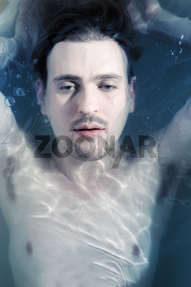 Portrait of a young man in the water