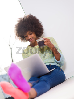 black woman in the living room on the floor