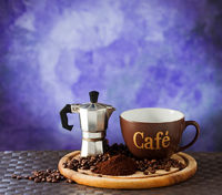 Coffee moka and cup with coffee beans