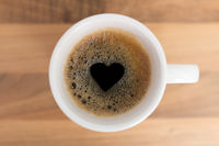 Cup of coffe with heart shape in foam