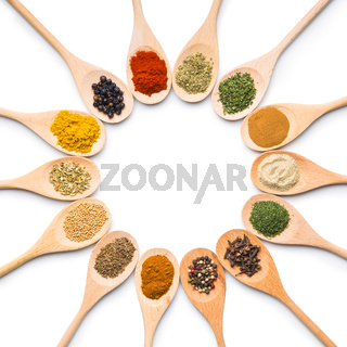 Various spices in wooden spoons.