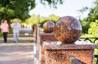 Granite balls of city fence, selective focus.