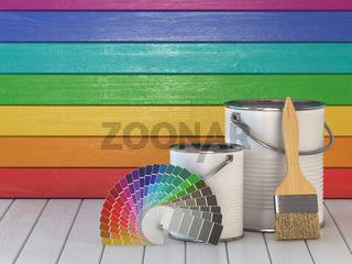 House renovation and improvement concept background. Paint cans, paint brush and color palette on wooden wall painted in a colors of the rainbow.