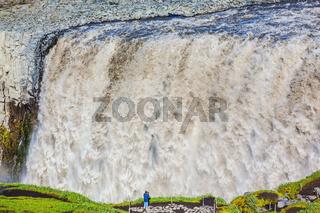 Elderly woman photographed waterfall Dettifoss