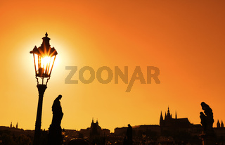 Sunset silhouettes of Charles Bridge in Prague