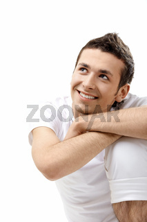 The young attractive man on a white background