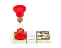 Hourglass and money - business concept