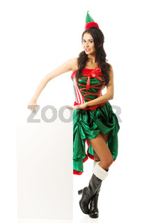 Full length woman wearing elf clothes holding white banner on the floor
