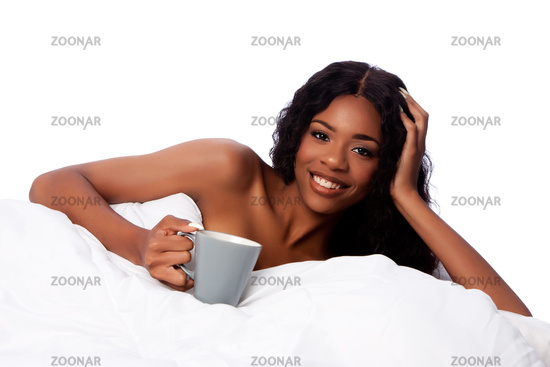 Happy waking up with coffee in bed
