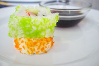 Cali crab with green and orange eggs and soya sauce bowl behind