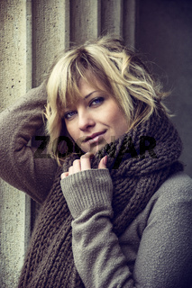 Attractive blonde young woman outdoors, looking at camera