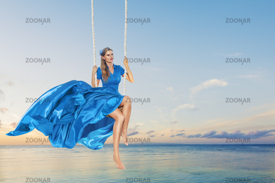 Woman enjoying swing
