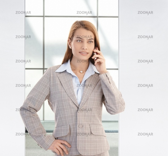 Confident businesswoman on mobile smiling